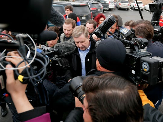 Republican Rick Saccone, center, is makes his way through