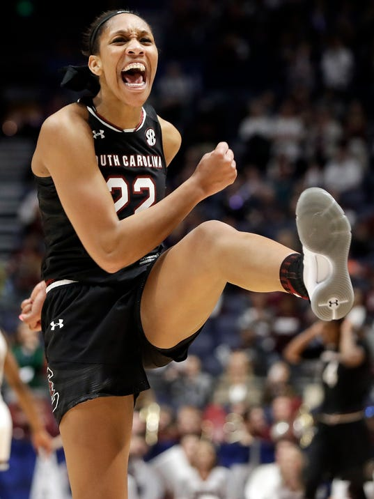 South Carolina forward A'ja Wilson celebrates after her team defeated Mississippi State in an NCAA college basketball championship game at the women's Southeastern Conference tournament Sunday, March 4, 2018, in Nashville, Tenn. (AP Photo/Mark Humphrey)
