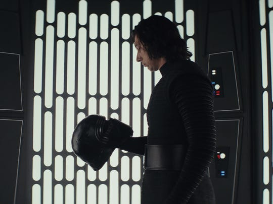 Kylo Ren (Adam Driver) in a moment of reflection during 'Star Wars: The Last Jedi.'