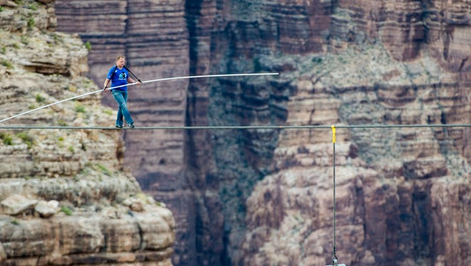 Nik Wallenda crosses the Grand Canyon on tightrope.