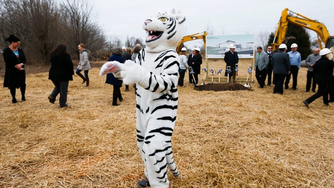 The Willard Tigers mascot waves at people at the groundbreaking for Willard's second intermediate school near the intersection of Mt. Vernon Street and South Miller Avenue in west Springfield on Tuesday, Feb. 13, 2018.