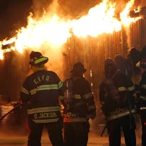 Firefighters from several departments assist East Fishkill firefighters in battling a blaze that destroyed William Tell Hardware on Route 82 in Hopwell Junction late Saturday night May 23, 2015.