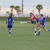 VVHS' Shantel Galindo battles with a Moapa Valley player for possession of the ball.