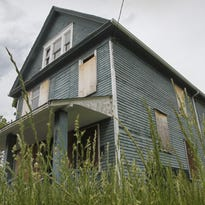 "A boarded up house on N. Union St. in Rochester is one of dozens of ""zombie"" properties in the city."