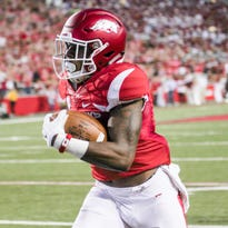 Arkansas cornerback and Island Coast alum Ryan Pulley produced an interception for a touchdown during Arkansas' 42-3 win over Texas State on Saturday.