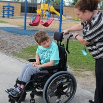 Student with disabilities uses playground for first time