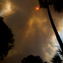Residents of 7,000 homes urged to flee Estates brush fire east of Naples
