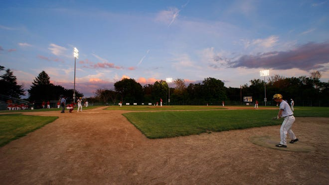 Holt and St. Johns play Thursday, May 26, 2016, at Kircher-Municipal Park. Fans were puzzled when there was no flag raised during the singing of the national anthem earlier that evening.