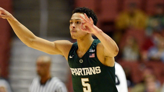 Michigan State guard Bryn Forbes (5) reacts after making a basket during the first half of the 77-64 win over Providence Sunday in Anaheim, Calif.