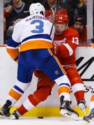 Islanders defenseman Travis Hamonic checks Red Wings center Pavel Datsyuk in the second period at Joe Louis Arena.