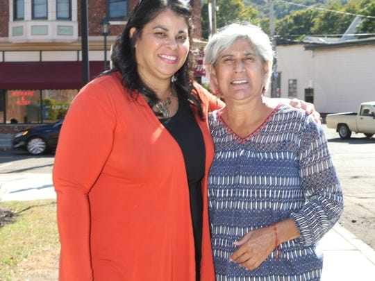 Emily Dominguez, 47, Village of Haverstraw deputy mayor and a local business owner photographed with Martha Robles, the director of Catholic Charities Community Services of Rockland, in front of Village Hall in Haverstraw on Tuesday, October 3, 2017.