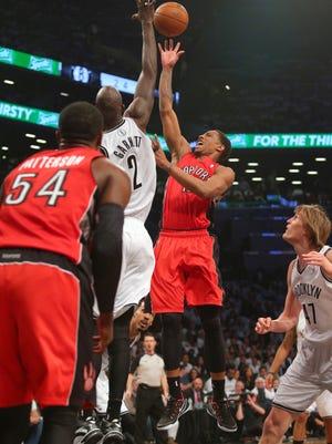 Toronto Raptors guard DeMar DeRozan drives against Nets center Kevin Garnett in Game 6 of their playoff series Friday in Brooklyn.