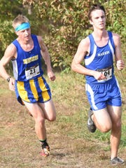 Mountain Home's David Byrd, left, runs with Marion's Gary Austin during the boys' race at the 6A-East Conference cross country meet on Tuesday at Mountain Home High School.