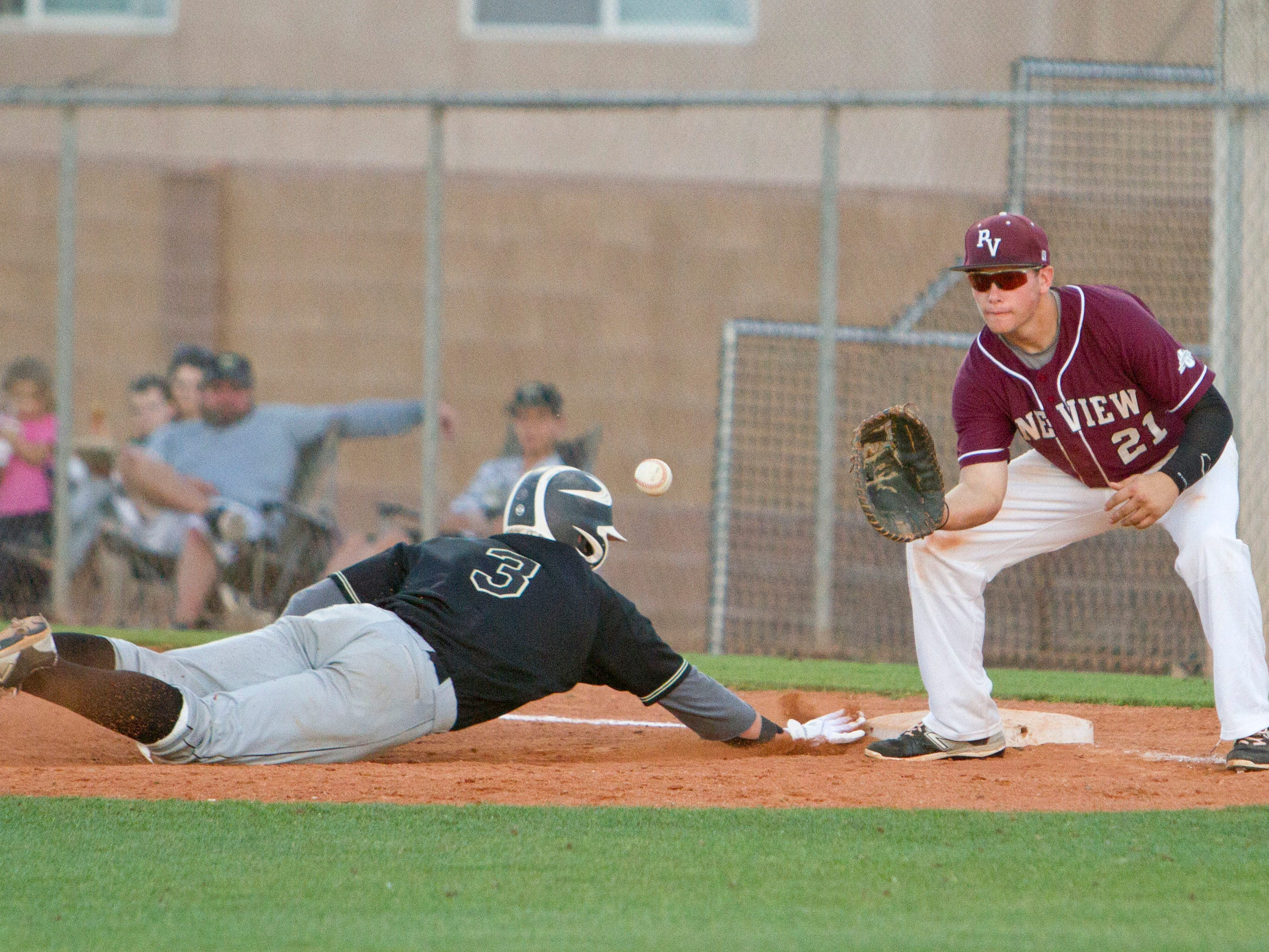 Pine View first baseman Brooks Barney attempts to pick off a Desert Hills runner at first base Tuesday in St. George.