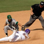 LSU's Kade Scivicque (22) is tagged out at second base by Southeastern Louisiana second baseman Jacob Williams, top left, during the Tigers' 8-4 come-from-behind win over the Lions.