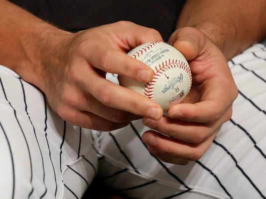 New York Yankees Alex Rodriguez holds the baseball of his 3,000th career hit during a news conference, Friday, July 3, 2015, in New York. Rodriguez received the ball back from Zack Hample, a fan who caught the solo home run to right field on Friday, June 19, against the Detroit Tigers. (AP Photo/Julie Jacobson)