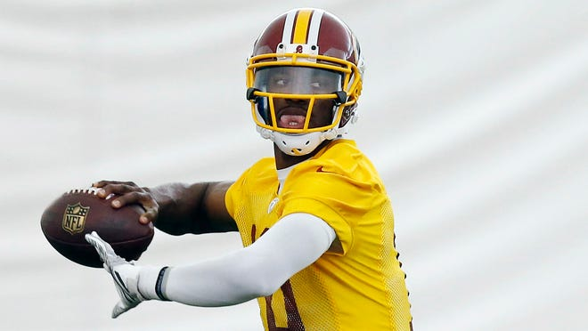 Redskins QB Robert Griffin III loads up to pass with no knee brace in sight.