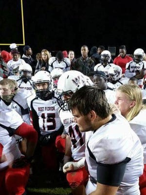 West Florida High's Kyle Harrison and his teammates have a post-game meeting during his senior season in 2015. Harrison died Monday after being hit by a car Wednesday.