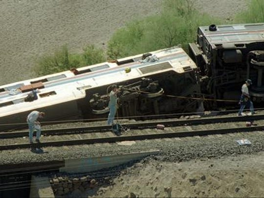 Federal investigators search for evidence at the scene of the Amtrak Sunset Limited wreckage about 70 miles southwest of Phoenix Oct. 9, 1995.