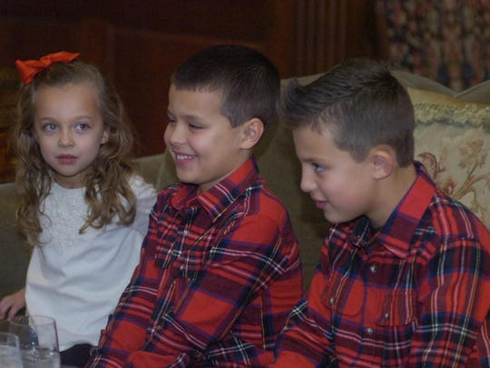 Ava Schlesener, 5, and brothers, Ronin, 8, and Brogan, 9, get ready to meet with Santa.