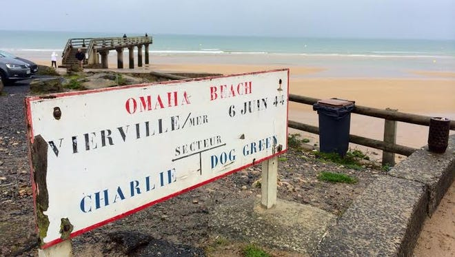 A sign near where World War II turned in the Allies favor, after a bloody assault on Omaha Beach in Normandy, France.