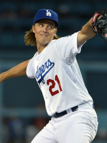 Dodgers starter Zack Greinke pitches against the Giants.