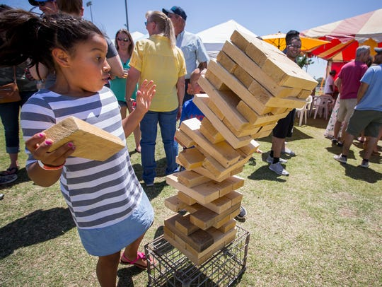 8-year-old Eternity Saenz reacts when a tower of blocks