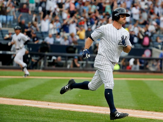 New York Yankees' Brett Gardner, right, heads up the first base line after hitting an RBI base hit that allowed Jacoby Ellsbury to score the winning run against the Tampa Bay Rays during the ninth inning of a baseball game, Saturday, July 29, 2017, in New York. The Yankees won 5-4.