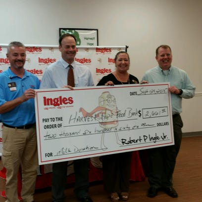Representatives from Ingles and Milkco donated more