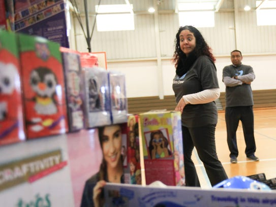 Lakara Blanding, left, and Robert Cooper, from AmeriHealth Caritas, deliver toys to the Police Athletic League of Wilmington Thursday.