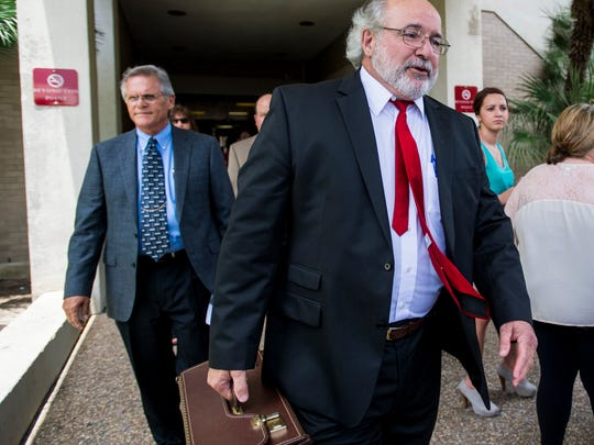Assistant District Attorney Jay Prather exits the Lafayette Parish Courthouse in downtown Lafayette, La.,  following the sentencing hearing of Seth Fontenot on Wednesday, July 8, 2015. Fontenot was convicted of manslaughter and two counts of aggravated in the February 2013 shooting death of Austin Rivault and injury of Cole Kelley and William Bellamy