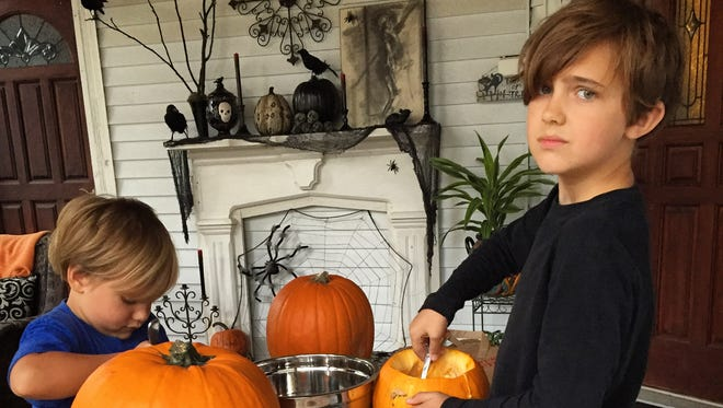 Liam doesn't like the pumpkin guts. But he loves everything else about Halloween.