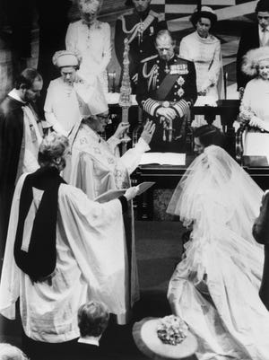 The Archbishop of Canterbury Robert Runcie blesses Charles, Prince of Wales, and Lady Diana during the marriage service in St Paul's Cathedral, on July 29, 1981.