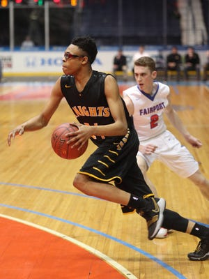 McQuaid's Jermaine Taggart drives past Fairport's Tommy Lindstrom (2).