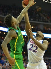 Kansas Jayhawks forward Dwight Coleby (22) is guarded by Oregon Ducks forward Jordan Bell (1) during the second half in the finals of the Midwest Regional of the 2017 NCAA Tournament at Sprint Center.