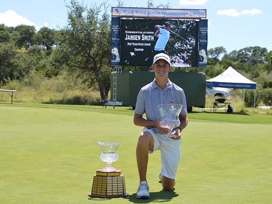 Jansen Smith poses with his trophy after winning the Texas State Junior Championship at Summit Rock Golf Club in Horseshoe Bay. Smith hit a 72-yard eagle on the final hole to win by one stroke.