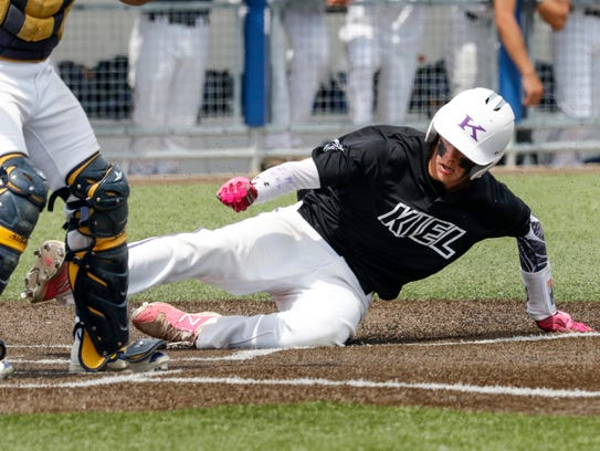 Kiel's Trenton Nickel slides into home to score the Raiders' only run during last year's WIAA state summer baseball tournament in Mequon. This season's state summer tournament will be the last before teams move to spring baseball.
