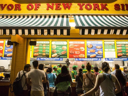 People wait in line at Nathan's hot dogs at Coney Island