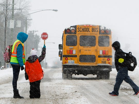 Colette Webb, left, and her daughter Gabriella, 7, work as crossing guards at the intersection of Greyhound Drive and Iverness Street between Lockwood Elementary and Greyhound Intermediate School as part of a Girl Scouts Troop 30031 Brownie Quest project, Wednesday afternoon, Feb. 4.