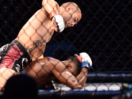 """Frank """"The Crank"""" Camacho defeats Tyrone """"Bones"""" Jones by TKO in the 155-pound main event at PXC 50 in the UOG Calvo Field House on Dec. 4, in this file photo."""
