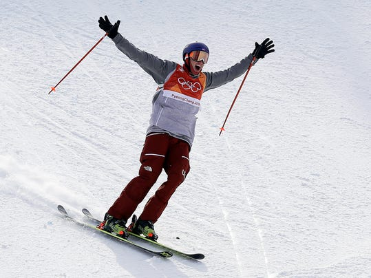 Silver medal winner NickGoepper, of the United States, reacts after his run during the men's slopestyle final at Phoenix Snow Park at the 2018 Winter Olympics in Pyeongchang, South Korea, Sunday, Feb. 18, 2018. (AP Photo/Gregory Bull)