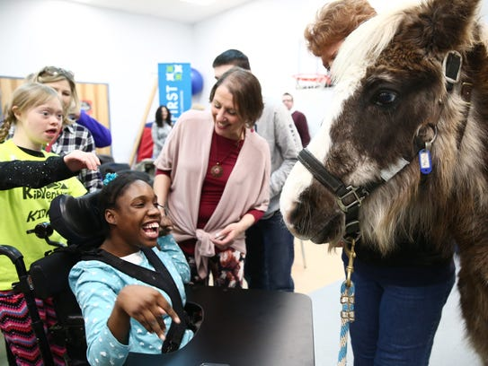 From left, Grace Hudson and Chy'Anne McCullum react to Mocha the pony during Tuesday's press conference for Hudson Valley KidVenture at Abilities First in Poughkeepsie.