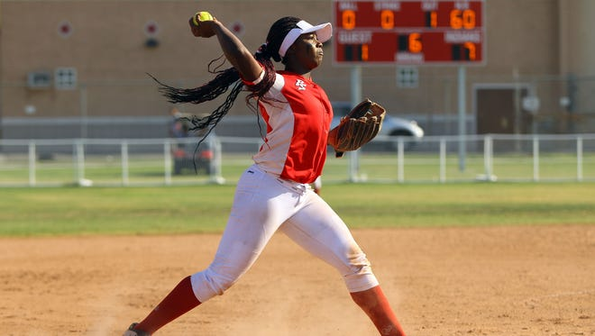 Palm Springs pitcher Makayla August throws to first base after fielding a La Quinta ball during a home game Tuesday, April 12, 2016. Palm Springs won, 7-4.