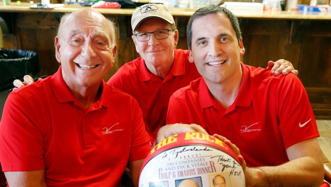 Dick Vitale, Dan Gable, and Steve Prohm sign basketballs during the 6th Annual V Foundation golf outing for Cancer research at Talons of Tuscany in Ankeny Wednesday, June 22, 2016.