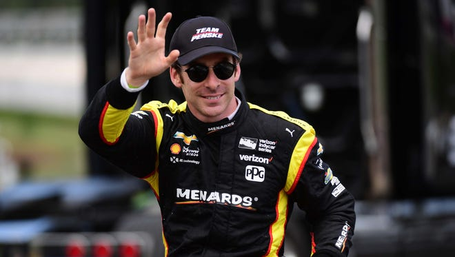 Verizon IndyCar Series driver Simon Pagenaud (1) waves after driver introductions during the Honda Indy Grand Prix of Alabama at Barber Motorsports Park.