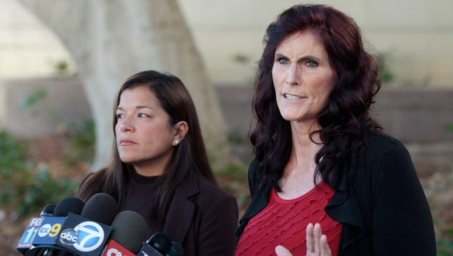 """Cindy Lee Garcia, right, one of the actresses in """"Innocence of Muslims,"""" and attorney M. Cris Armenta hold a news conference before a hearing at Los Angeles Superior Court in Los Angeles, Thursday, Sept. 20, 2012."""