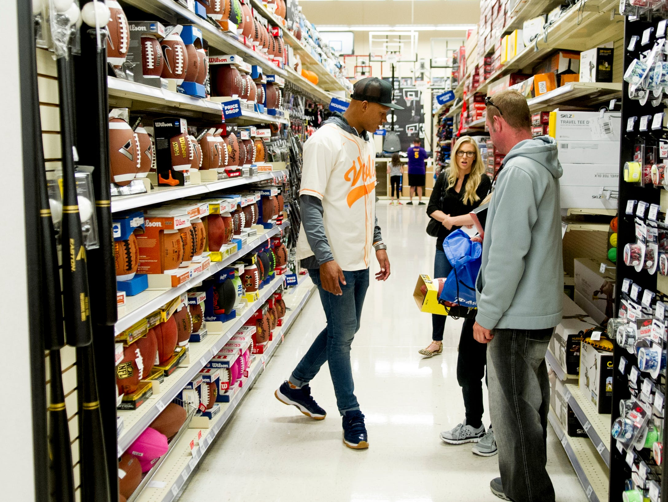 Former UT QB Joshua Dobbs shops with Matthew Scott, 8, of Sevierville, during a football sporting goods shopping spree at Academy Sports + Outdoors in Knoxville, Tennessee on Friday, March 31, 2017. Dobbs held a shopping spree for 11 area kids who are participating in his football camp.