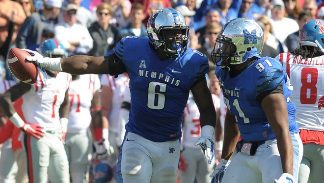 Memphis linebacker Genard Avery (6) and defensive lineman Ricky Hunter (91) celebrate a turnover against Mississippi on Saturday.