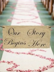 Ribbon across the entrance to the aisle with a cute sign.