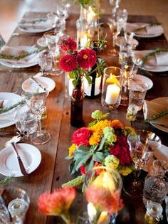 Multiple sizes, textures, flowers and candle mix for a festive table.